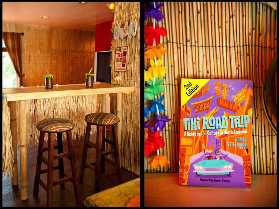 The Tropical Bar with seating for 2 and souvenir decor items create a charming ambiance