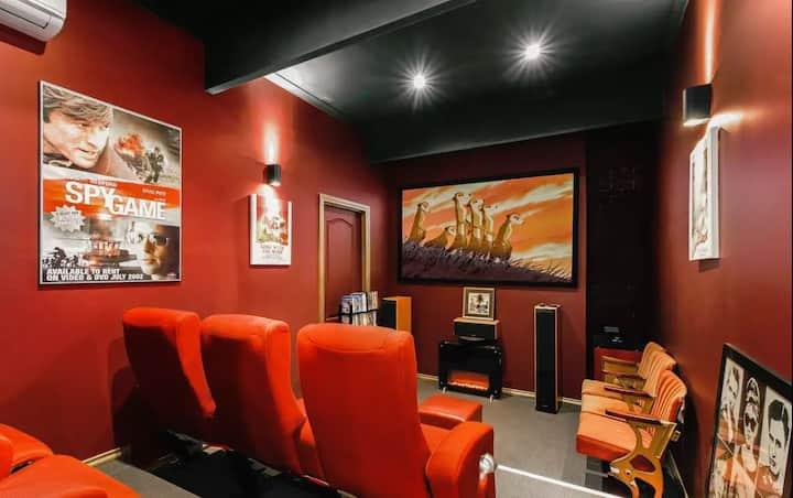 Enjoy a Cinema experience, multiple living areas!