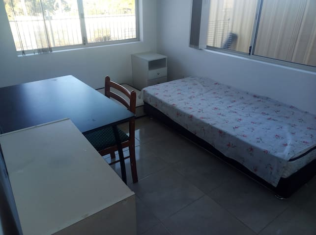 2 single bed in a new built house room with tables