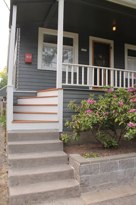Beautiful walk up stairs lead to the front of the house