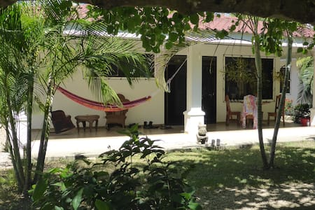 Come stay in an oasis of serenity and privacy, a hidden gem in the center of town only a block from the sun-drenched beach of Playa Samara. Seven houses are for rent on this gated property surrounding the lush green gardens and refreshing pool!
