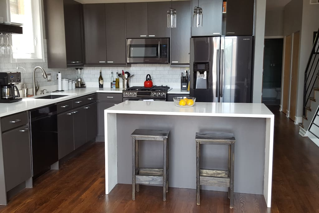 Upgraded kitchen with stainless steel appliances.