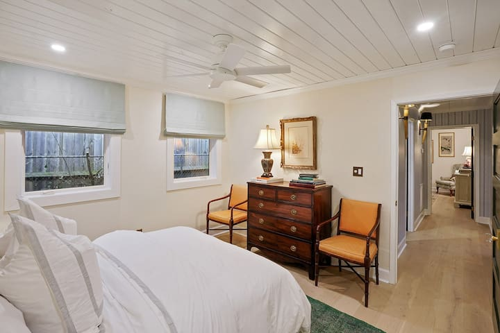 Relaxing, spacious bedroom featuring a Queen size bed, crisp, white, Suzanne Kasler bed linens. Ensuite closet for added convenience.