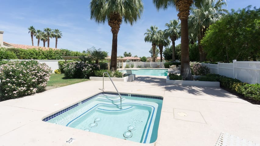 Spend sun-soaked afternoons around the shared pool and jacuzzi.