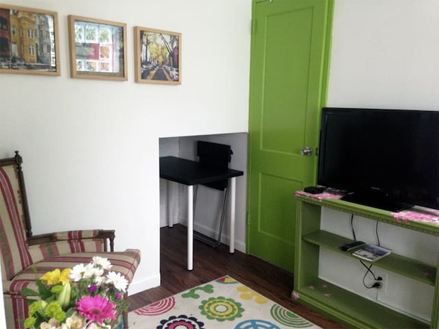 The cozy living area features a TV with Netflix, ample room to store luggage and a hidden desk.