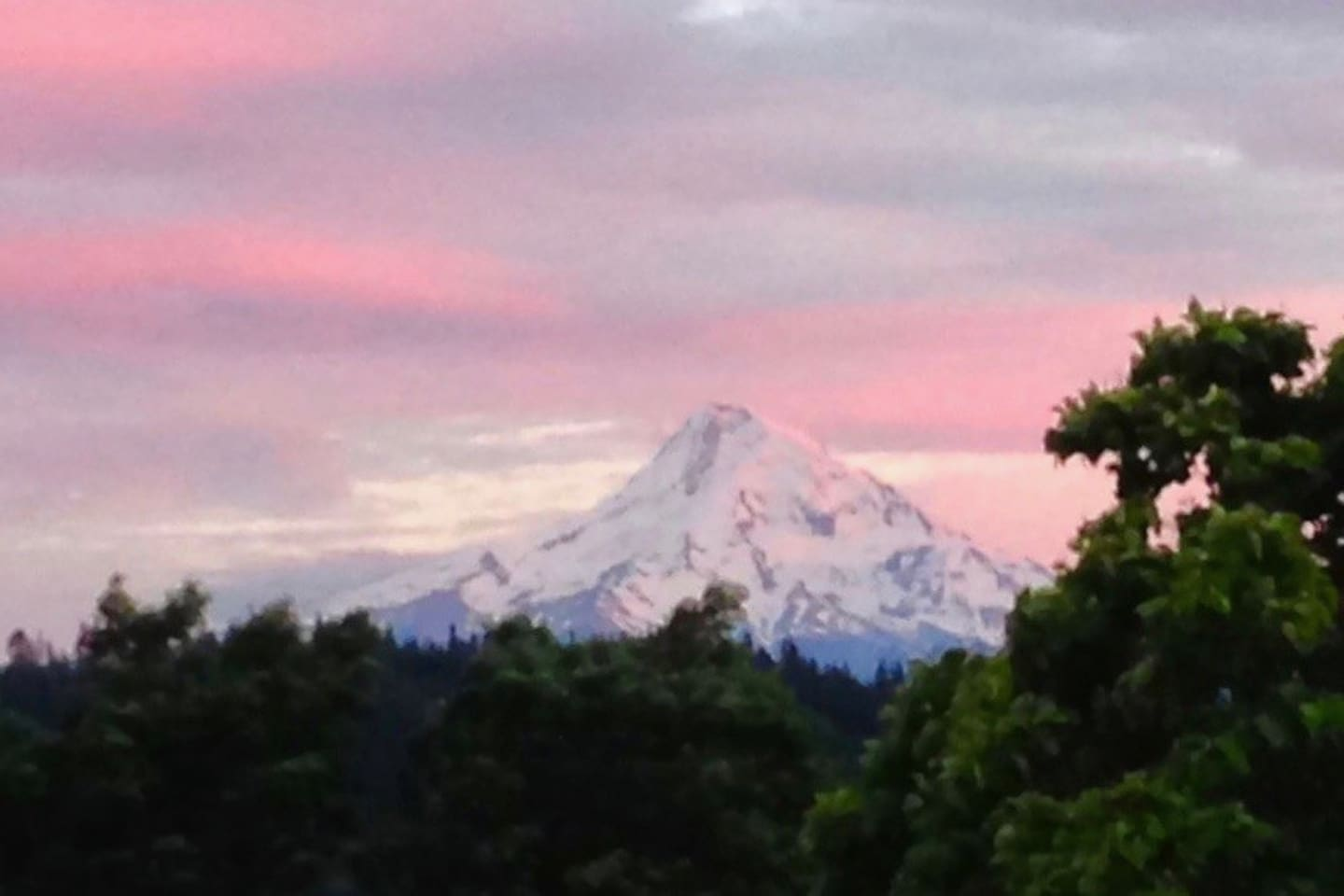 Spectacular summer sunset over Mt Hood from entrance.