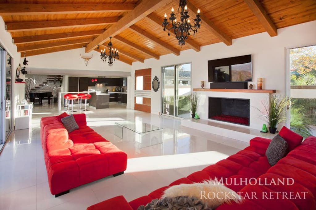 Living Room, Italian Furniture, Modern, Sleek, but warm and Inviting, Teak Wood ceiling, Red Glass Fireplace, Ipad Controlled Audio /Video