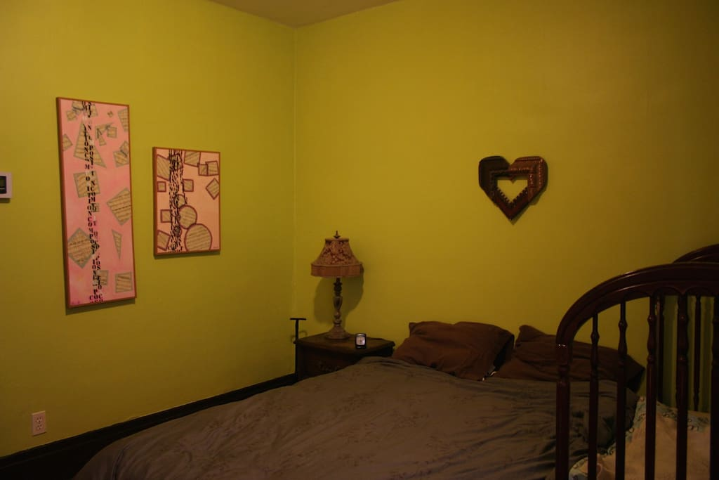 This is the family sleeping room. It has a queen bed, a toddler bed and a crib, as well a changing table.