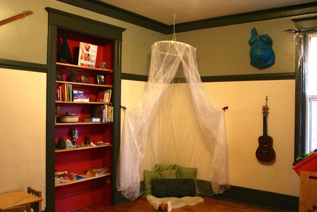 Our living room is catered towards children with an inviting canopy quiet corner. The basement is accessible from this room.