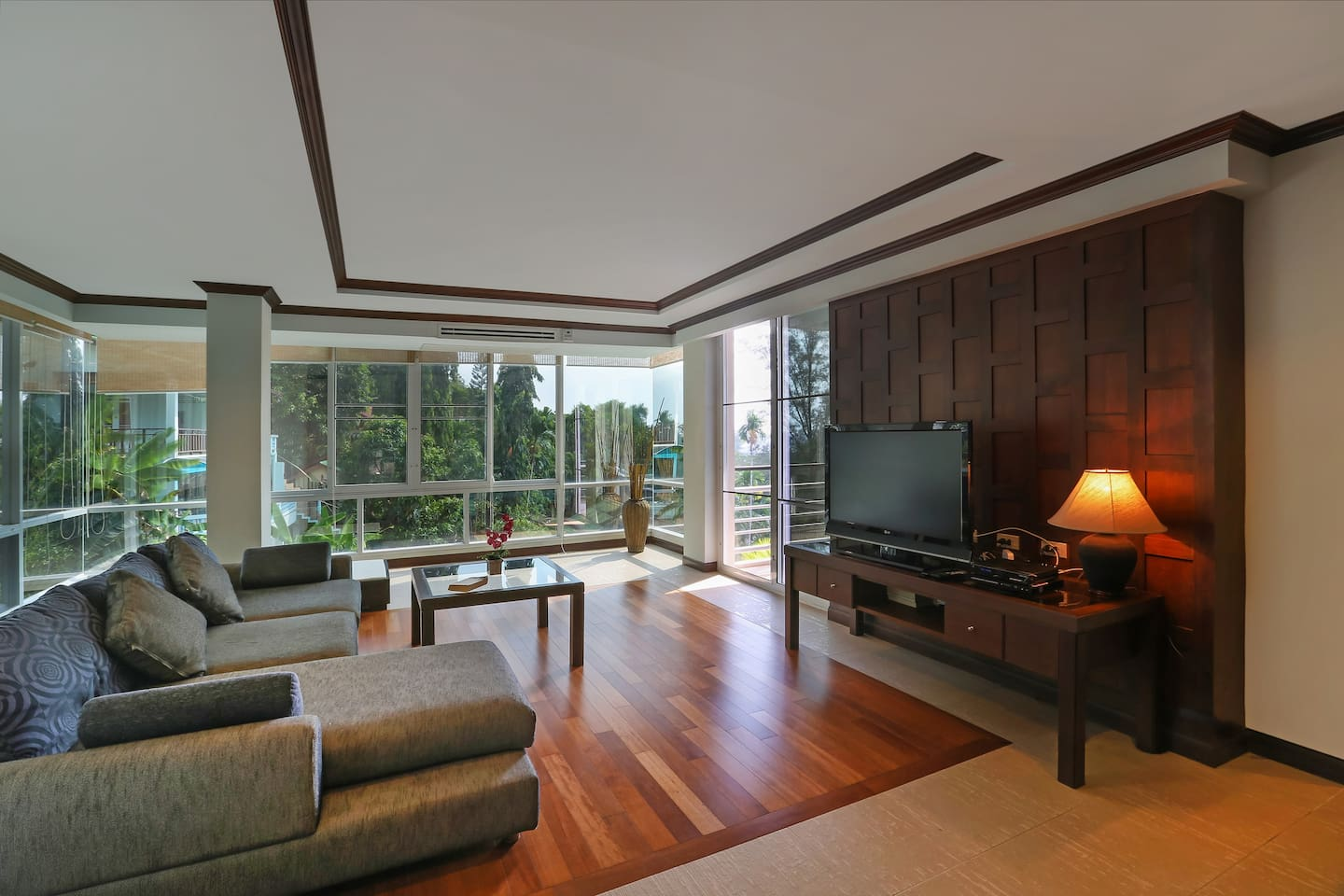 Living room with floor to ceiling windows on 3 sides and double sofabed
