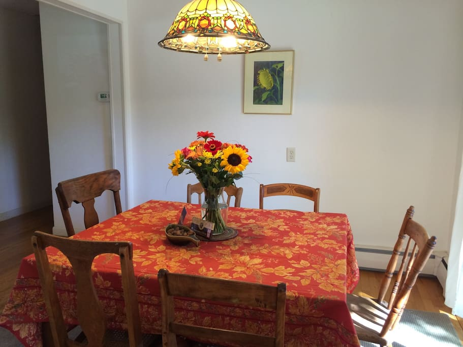 The sunny dining room; the table opens up further as needed.