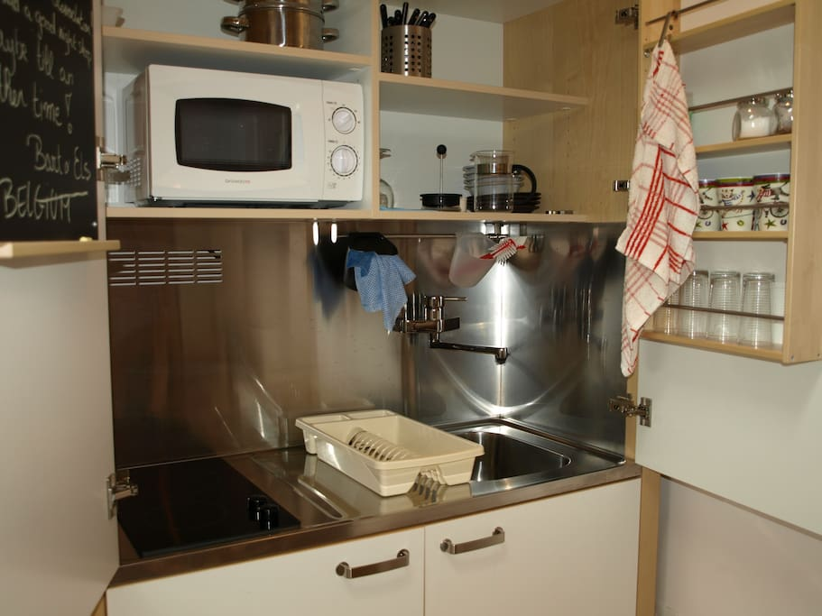 Kitchen that you can hide-away -with hob, sink, microwave, toaster, crockery, cutlery, pans.