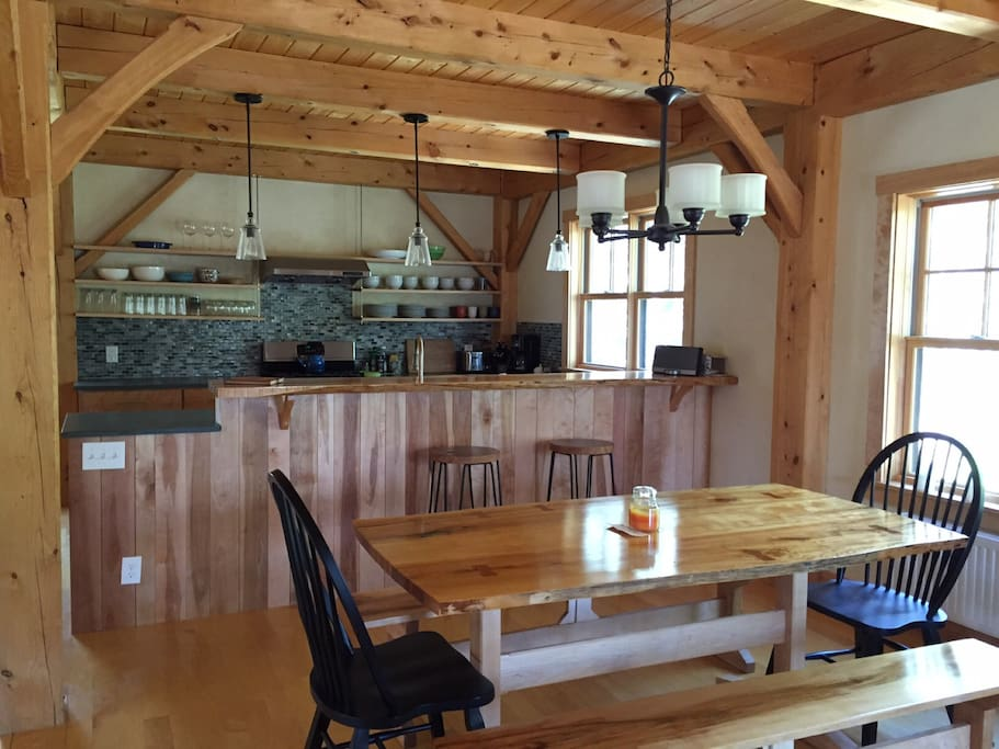 LED lighting in gourmet kitchen.  Live edge dining table for eight