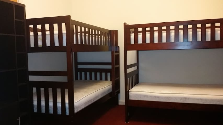 Roomy master room can accommodate up to 4 people