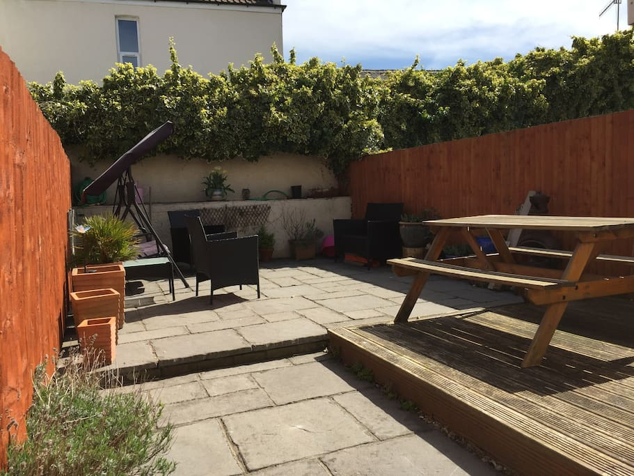 Sun trap garden with plenty of seating, great for alfresco dining.