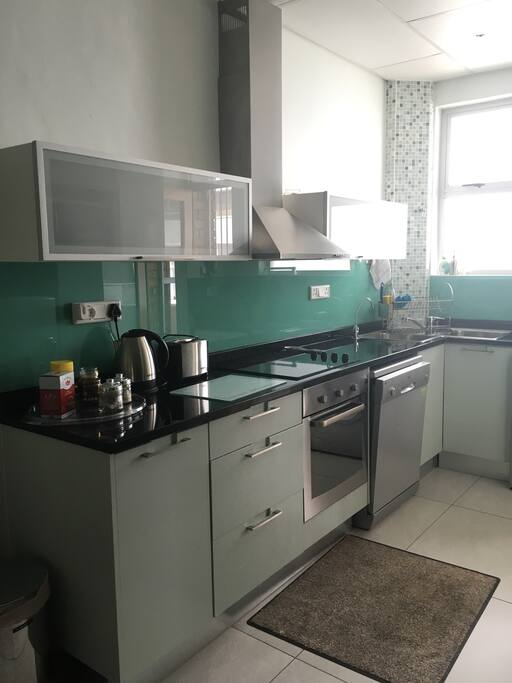 Fully fitted kitchen with built-in oven & hob, washing machine and dishwasher.