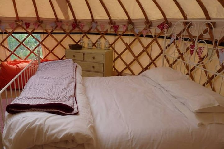 Cosy, comfy double bed with 2 single sofa chair bed complete with bedding.