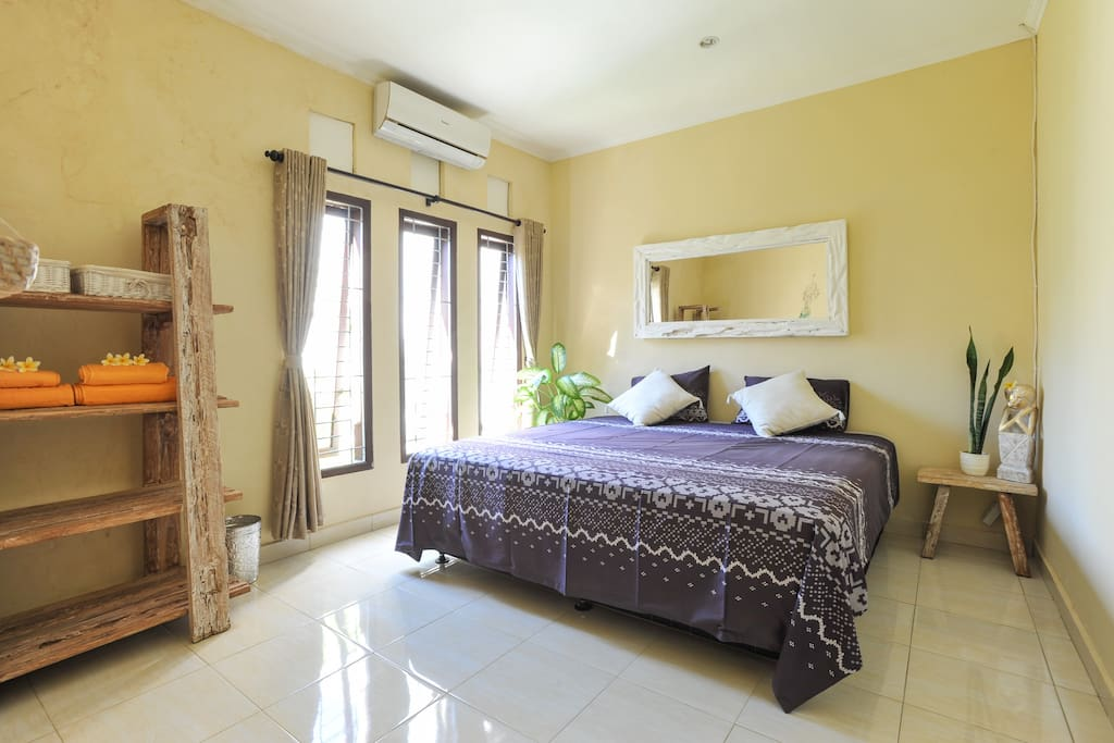Master bedroom with extra large king bed, 2 x 2 meter, with Air Conditioning and windows to the front garden
