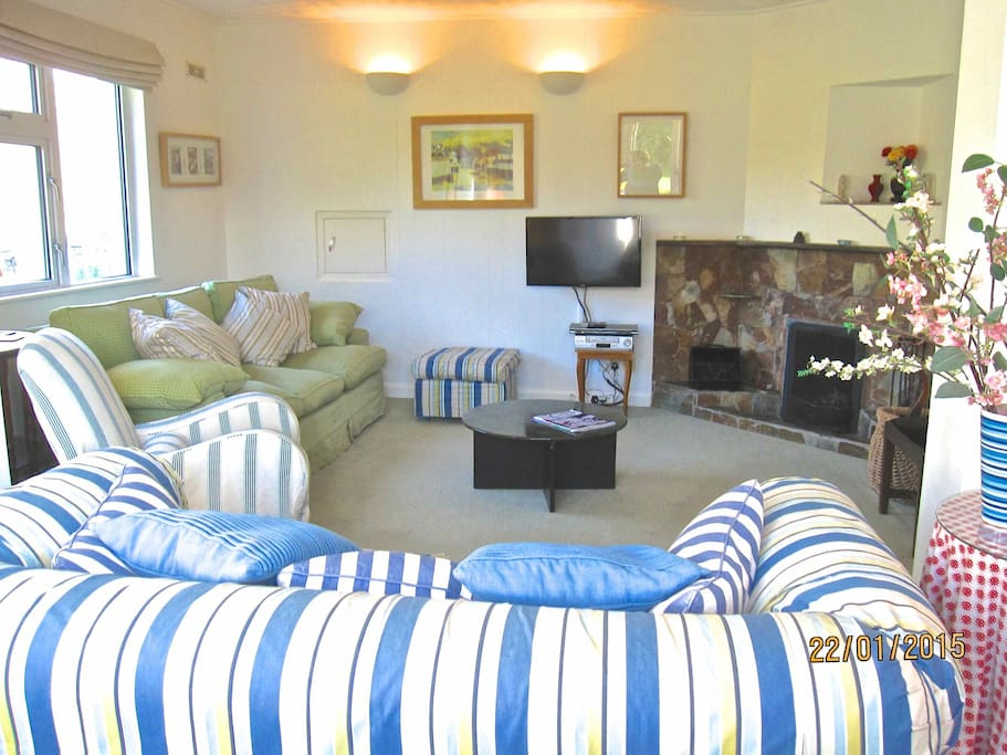 Comfy 4 and 3 seater sofas with an open fire, smart TV, DVD and video.