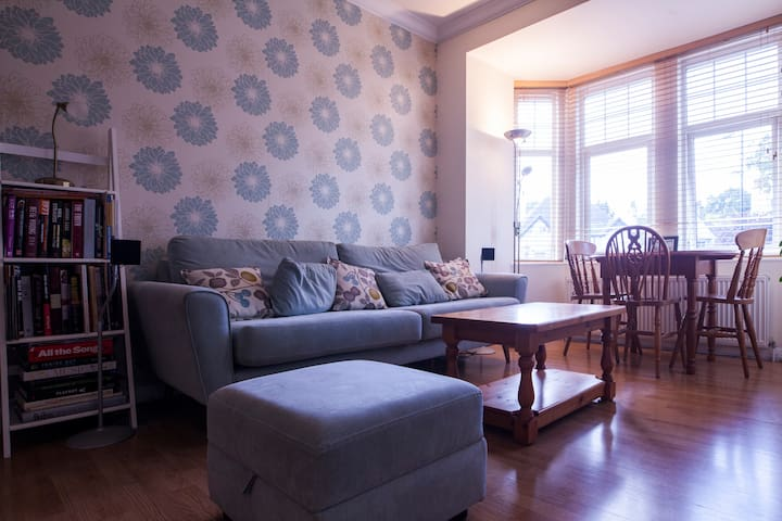 Relax in a comfortable living room with very large sofa and pine dining table that can extend if needed.
