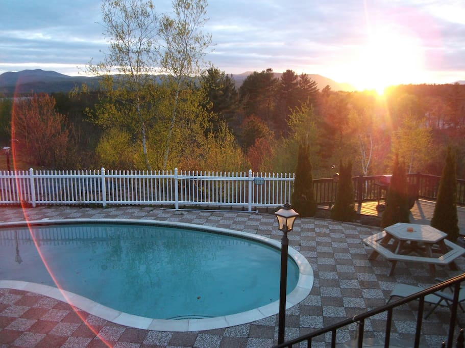 in ground kidney shaped pool overlooking views;sunsets