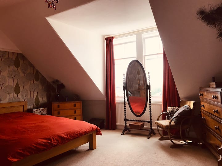 Spacious double bedroom in comfortable property.
