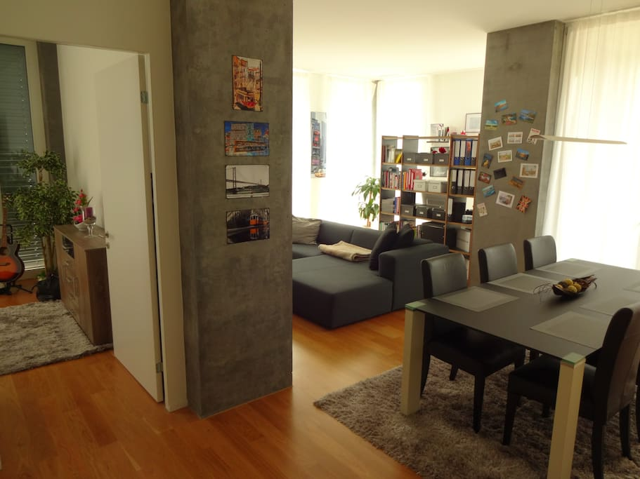 big living room with beautiful glass table and open kitchen. Big windows. Room height 3 meters.