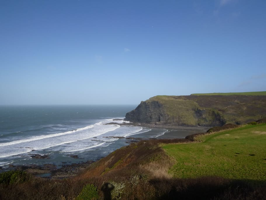 The view to the excellent surfing beach at Crackington Haven from the cliffs at Trevigue