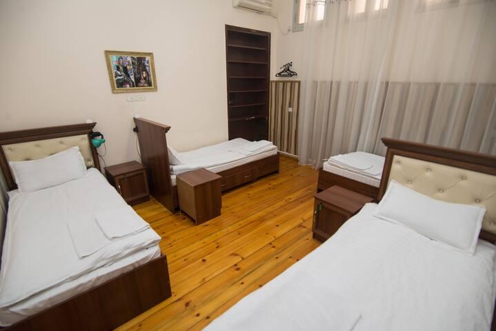 Bed in Quadruple Female Dormitory Room