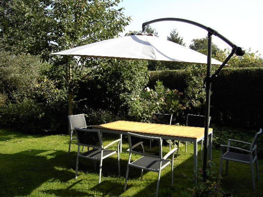 400 sqm sunny garden with several (fruit) trees,plants&flowers, outdoor furniture(incl.sunbathing chairs), shadow places as well