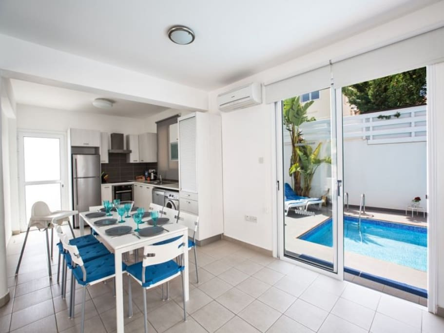 Dining area with patio doors leading to the pool