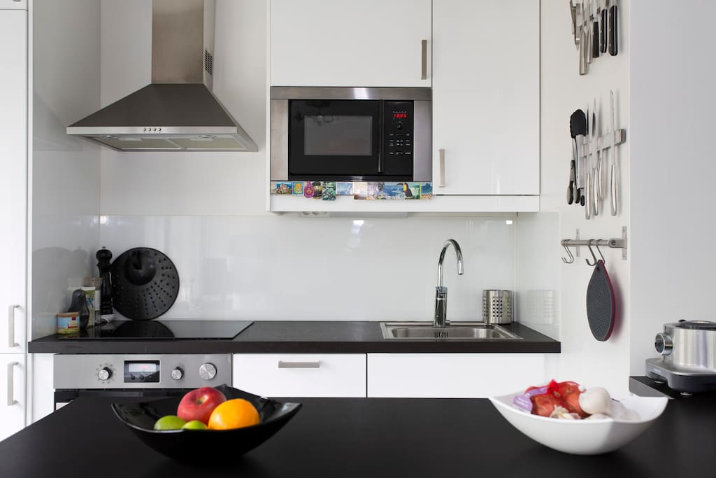 The modern kitchen with induction hobs/stove and washing machine