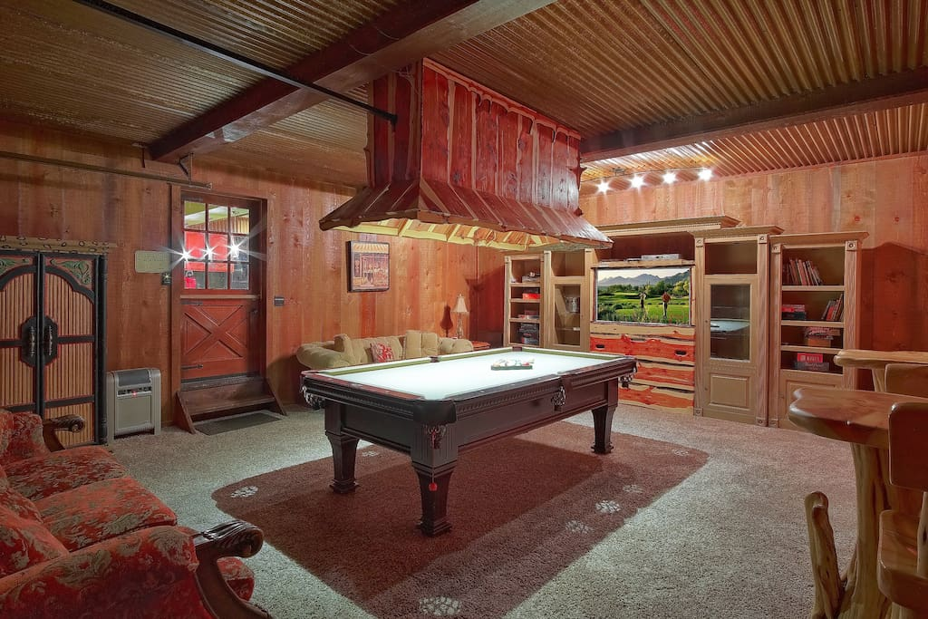 Play pool & other fun games or relax on even more comfy overstuffed sofas while watching a movie in our 500 square foot Super Cozy Fun Family Game Room or open the garage & watch Mother Nature do her thing.