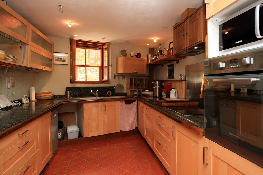 The modern granite topped kitchen has a large family fridge and is well equipped