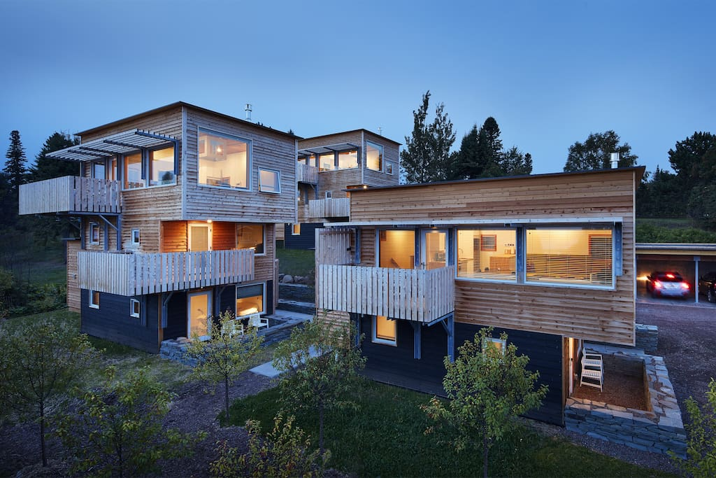 """The Aurora (front right) is one of the three sisters of """"tre søstre"""" which means """"three sisters"""" in Danish. Great views, balcony, patio... A tree lined path takes you to out of this micro neighborhood to the town. Each home is completely private."""