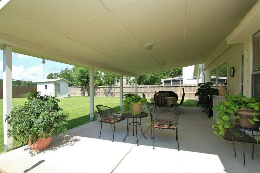 Nice covered patio where you can sit back and relax with a cup of coffee enjoying the view and the breeze.