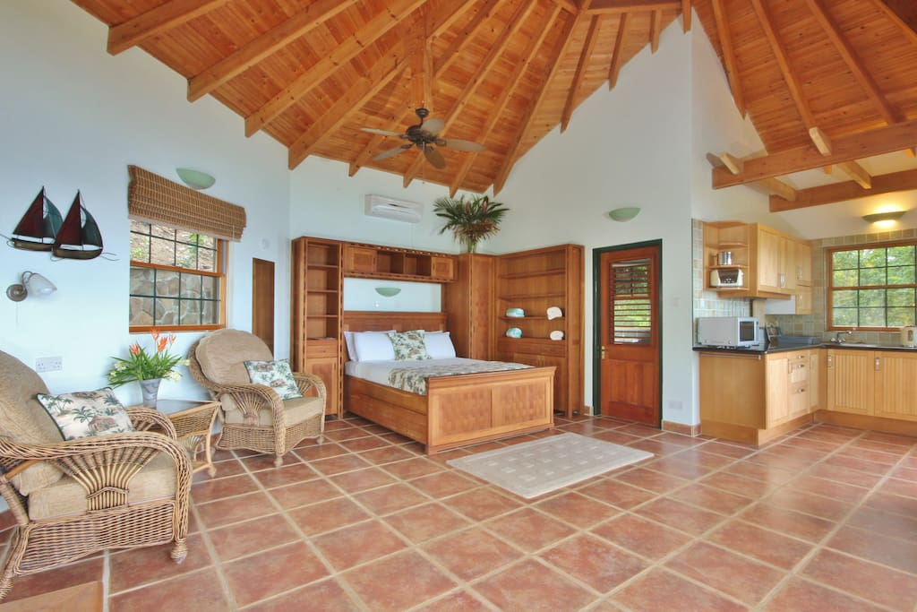 Hibiscus Cottage with it's rattan style armchairs, oak furnishings and open plan design.