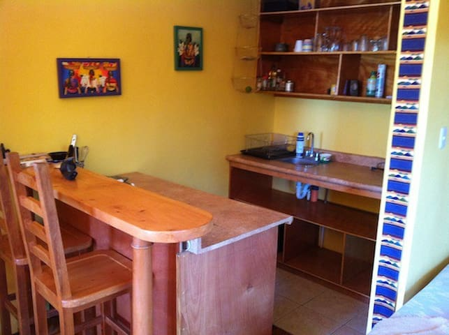 Also includes an interior kitchenette/bar.
