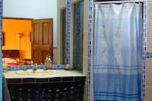 Private bathroom with hot water, and sauna-style shower.