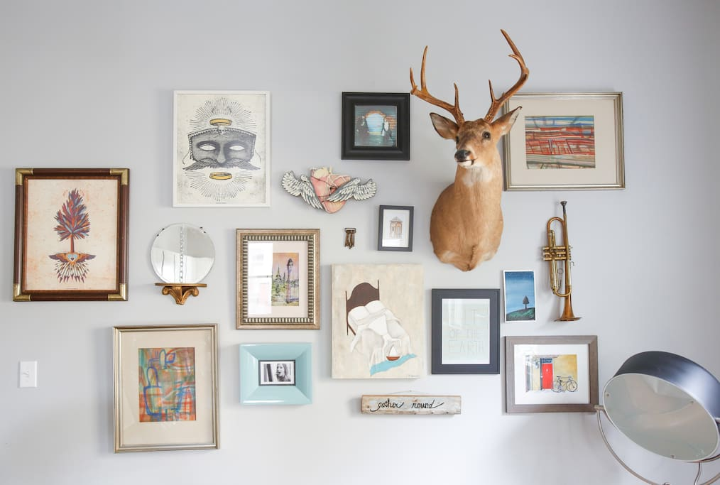 An eclectic gallery wall in the living room.
