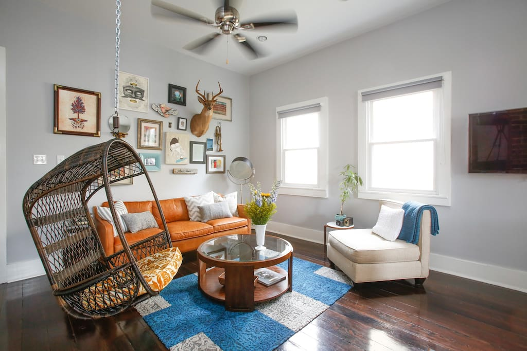 Guests always love the swing chair in the living room. Great for curling up to read a book or watching movies.
