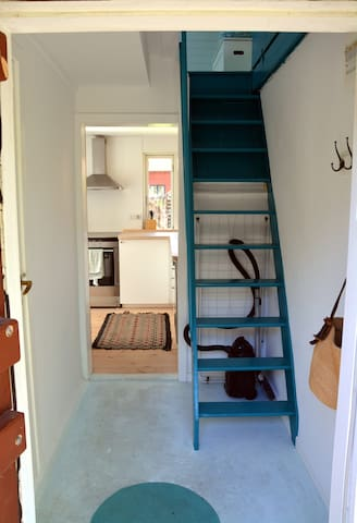 The entrance with the stairs leading to the upstairs bedroom.