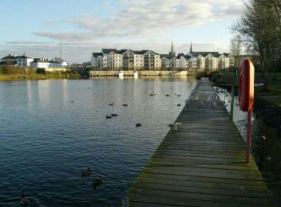 Across the road. The Round O Park. You take take a ferry to Devenish Island from there.
