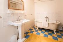 Main bathroom, with shower, bathtub and toilet (in addition to this main bathroom, there is a separate toilet and a second bathroom with  shower)