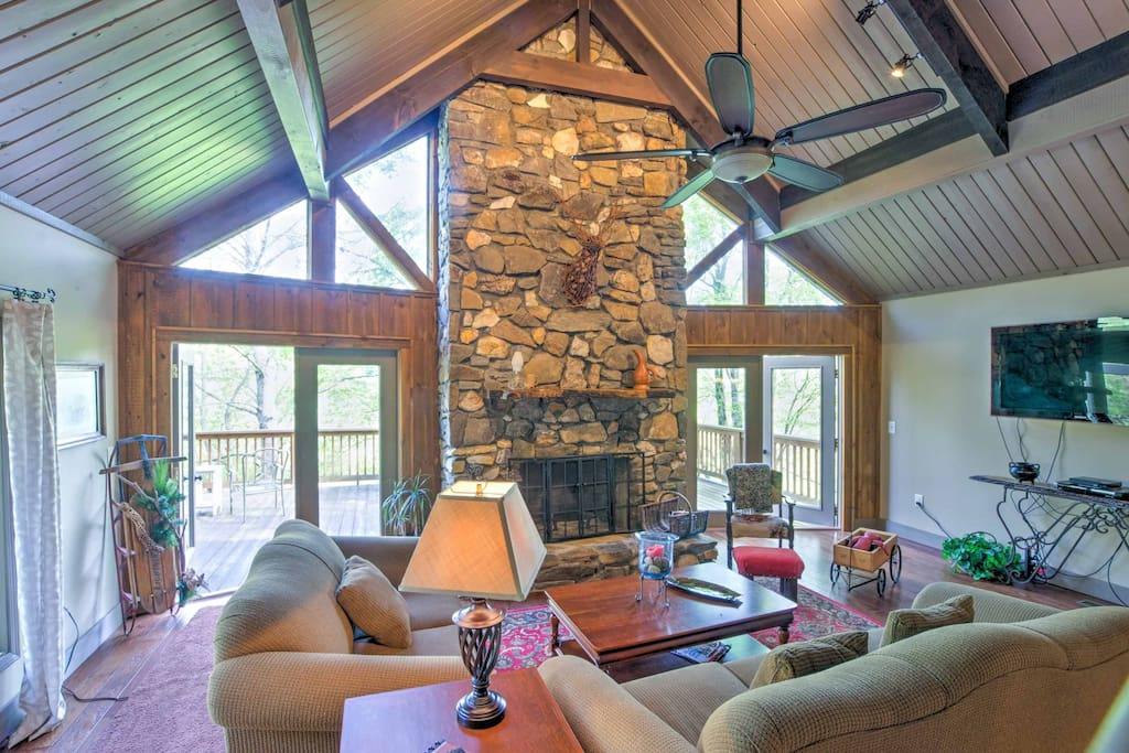 Step inside and make yourself at home in this elegant 3 story vacation rental that features cathedral ceilings, wood beams, and floor-to-ceiling windows.