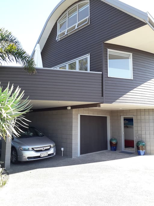 Ocean Cove ( 3 -levels )  showing main Entry door , & also  showing carport area for parking & also the 2nd parking space being in front of the carport & main door.