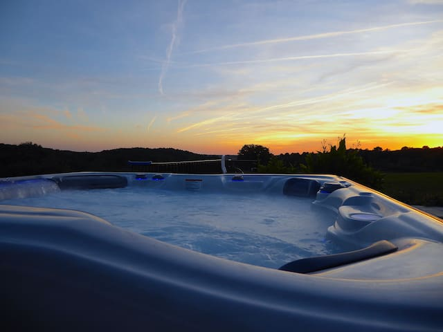 Admire the spectacular night sky from the luxury hot tub