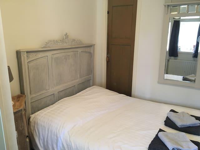 Gezellig appartement in de stad met een tuin