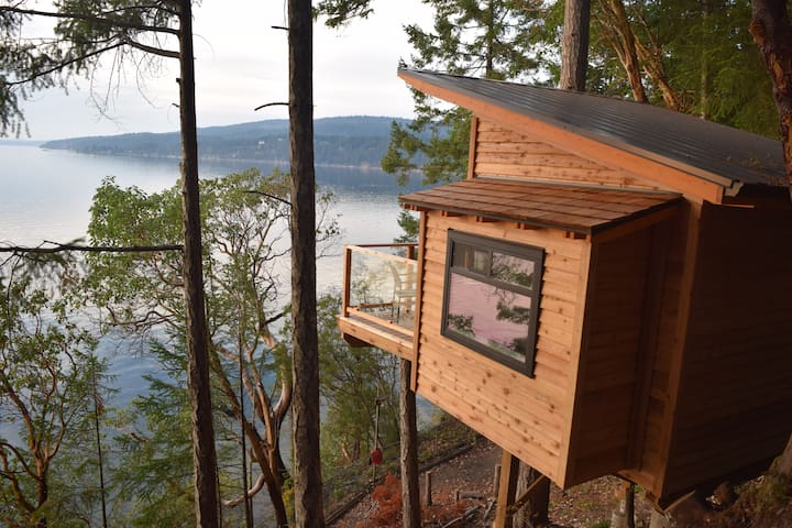 Room with a view and more!  Our treehouse overlooks the private beach and beyond.  The treehouse is secluded away from the main house with a private deck.