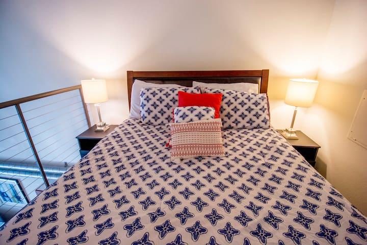 bedroom with super cozy plush queen bed